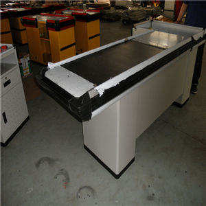 checkout counter with conveyor belt used for supermarket