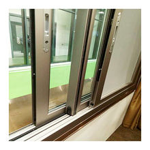 Custom two or three track bronze color sliding windows and doors frames