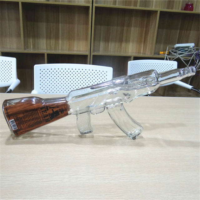 New 750ml cool terrific gun shaped glass bottles for ak 47 in color silk screen printing with cork