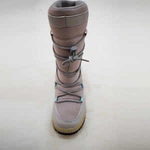 women lace up snowboots with PU trim