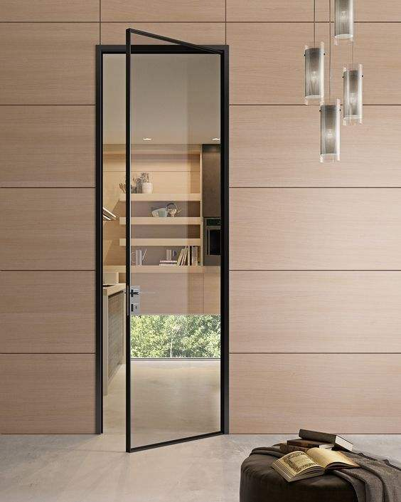A New thin profile in aluminium with single 8mm thick glass door