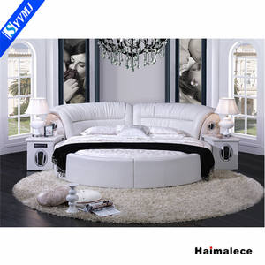 Hot selling white color romantic wedding modern soft italian leather round bed with 2 CD player for sale
