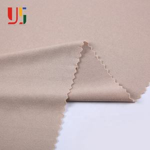 Cheap custom 96 polyester 4 spandex DTY brush knit single jersey fabric rolls for women fashion garment