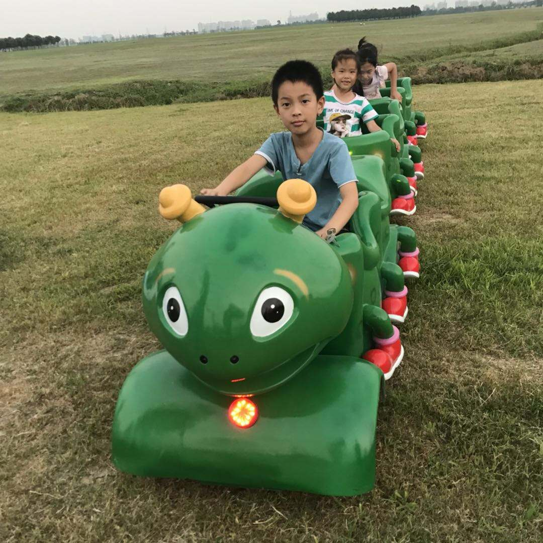 Outdoor Mini Kiddie Amusement Park Green Worm Trackless Train Ride For Sale