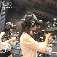 Business opportunities  theme park 4 players 9d vr machine multiplayer Virtual reality gaming machine battle 9d vr platform