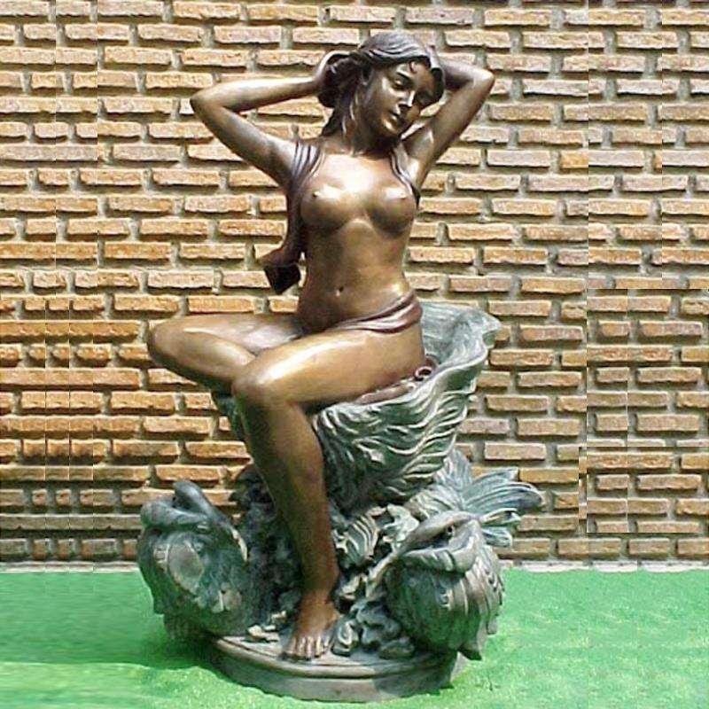 Nude girl seated on rock