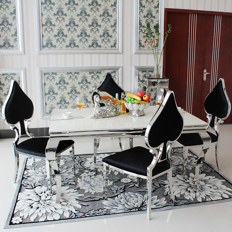 Fashionable white top marble dining table set with 4 seater black heart shape chairs