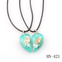 2019 Latest hot selling resin pendant Jewelry necklace genuine small sea shell Inside clear blue green necklace