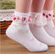 China sock factory design kids girl tube custom wholesale lace socks