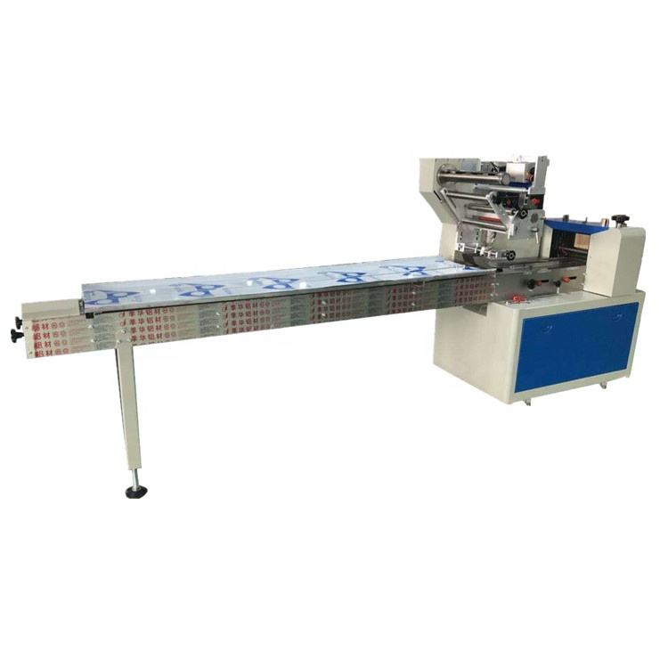Hot sale china machine candy pillow package equipment,frozen food bun dumpling packing machine