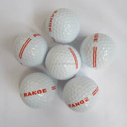 Brand new white driving range golf ball printed with red stripe