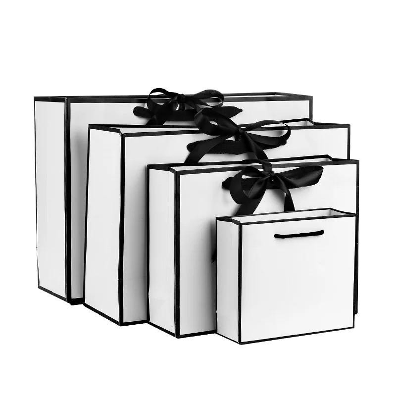Competitive Price Elegant Customized Brand Logo Luxury Boutique Shopping White Gift Bags With Bowknot