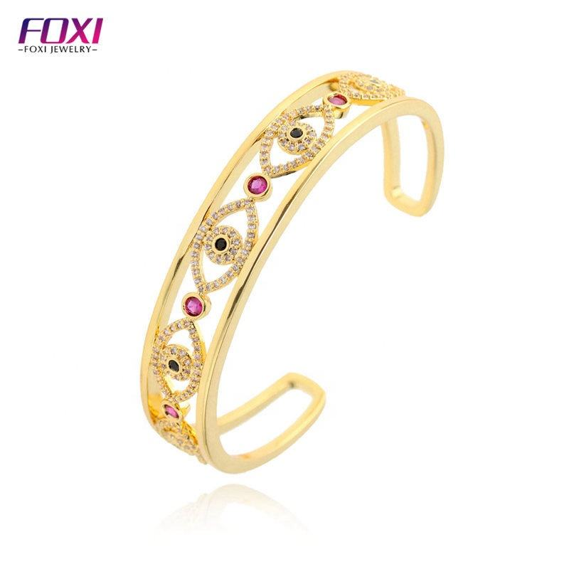 Wuzhou Foxi Jewelry Hollow Out Turkish Eyes 18k Gold Plated Cooper Alloy Bangle Bracelets