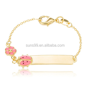 Stainless Steel Two Year Warranty Gold Overlay Id Bar Baby Bracelet With A Pink Ladybug & Flower Charm
