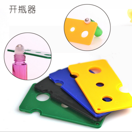 Good quality colorful plastic essential oil key tool,plastic essential oil bottle key opener