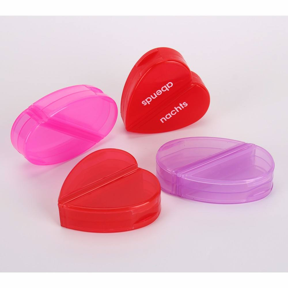 Hot selling heart shape Pill Package portable oval tablet container