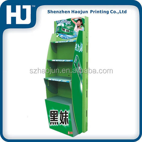 Green 4 layers cardboard shelf display stand for toothpaste in Supermarket for retail