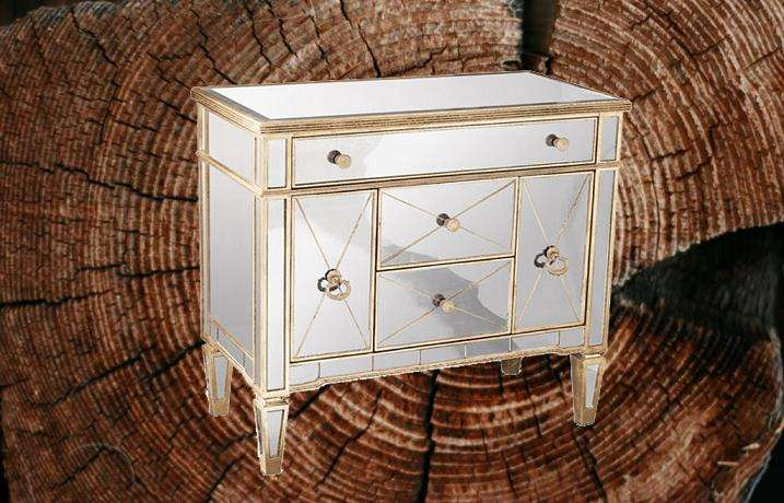 ZhaoHui Antiqued silver finish with antiqued gold-painted accents Five drawers Mirrored Chest