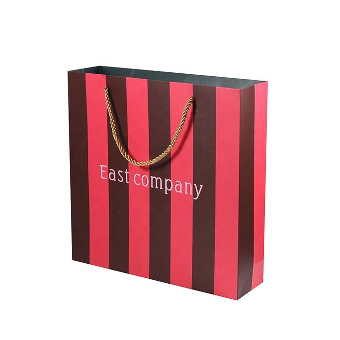 Flexo printing surface handling customized size coated paper bag with handle