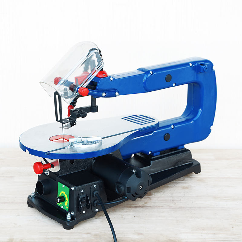 laser scroll saw woodworking machine with LED light and blower cutting wood