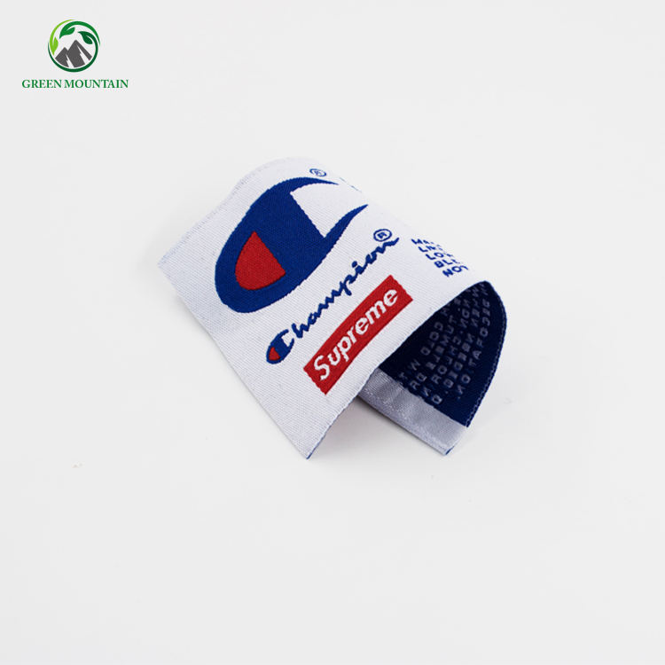 Custom made embroidered loop fold fabric labels