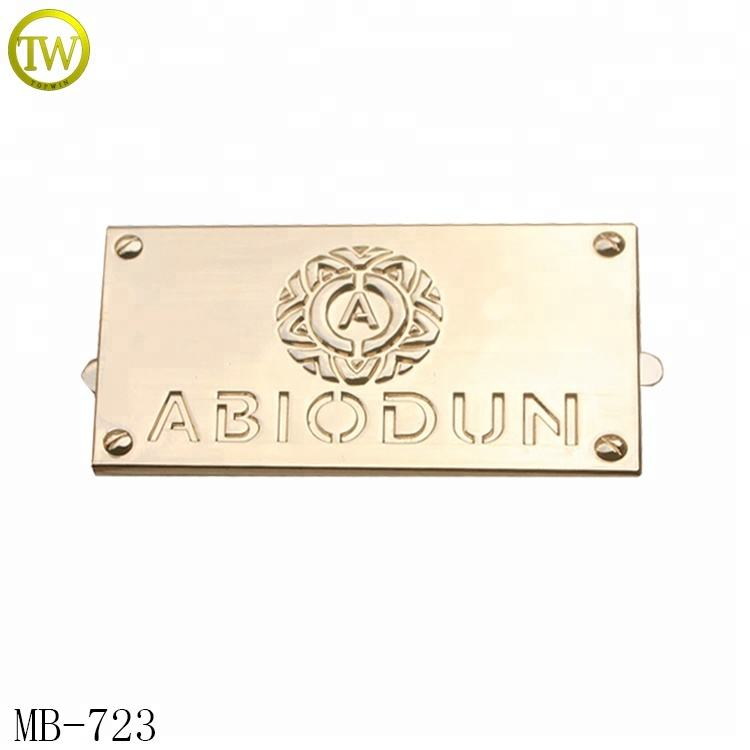 Zinc alloy made purse parts customized embossed name metal plates brand logos for handbags