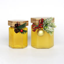Hot selling Bee Shape 100ml 200ml 400ml Hexagonal Glass Honey Jar with Bamboo Lid