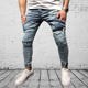 New men's biker jeans slim jeans stitching hole men's cowboy beam mouth blue feet pants motorcycle pants