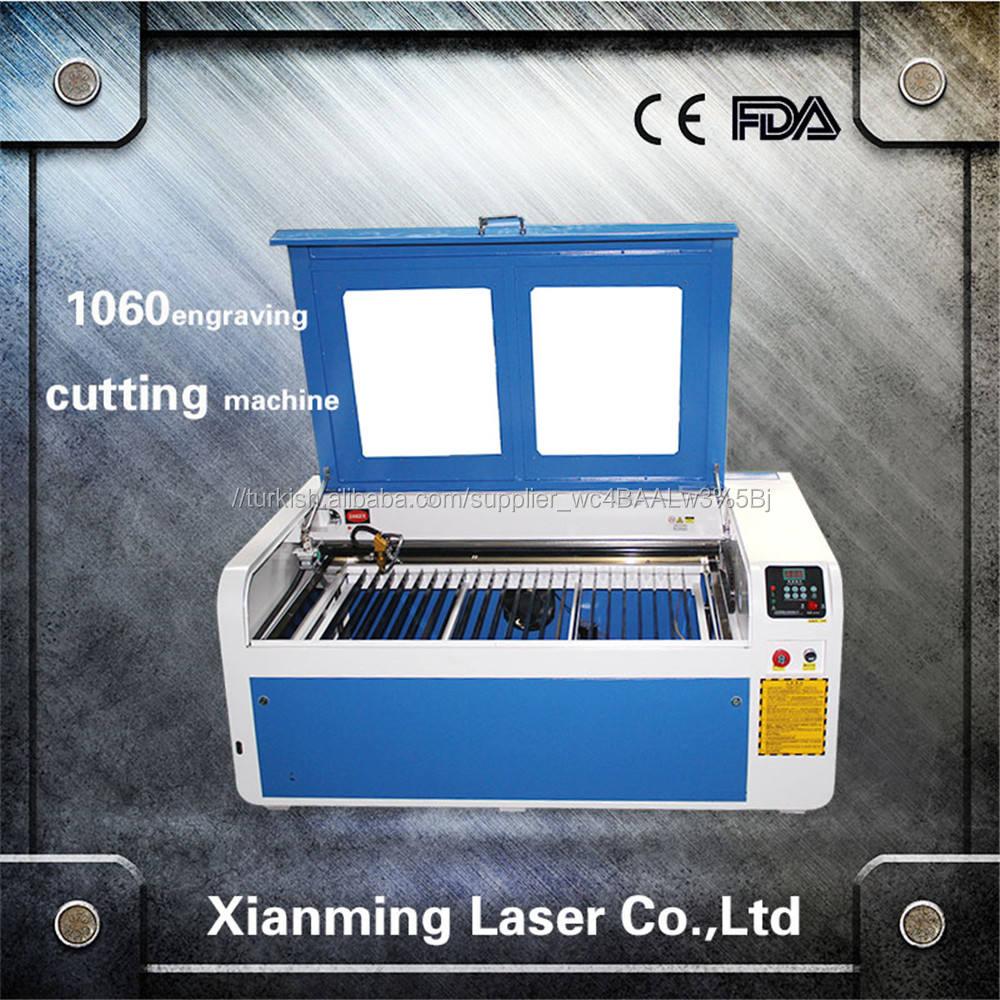 Giyim lazer gravür makinesi CO2 lazer tüp Lazer Oyma/Kesme Makinesi XM-1060 ile CE, FDA