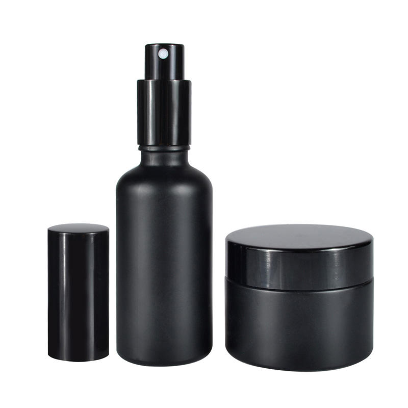 Hot sale 15ml 30ml 50ml 100ml frosted clear black glass cosmetic cream jar with black aluminum lid