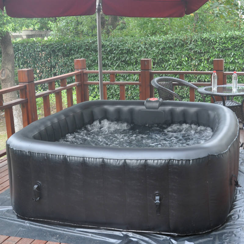 Portable inflatable hot tub with computer control