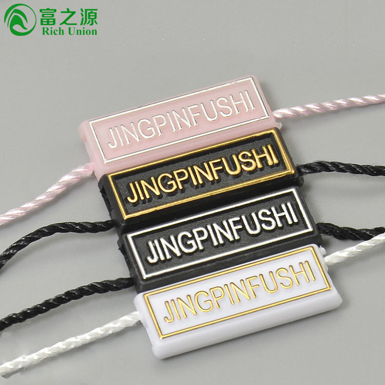 New designer custom embossed clothes string plastic garment seal cord punch china label clothes hang tag