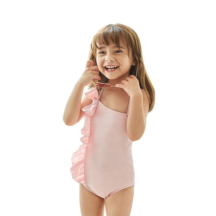 Plain dyed asymmetric neckline single knot side vertical little flounce one piece child girl's swimsuits