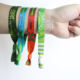 Free design plastic tube slide lock custom woven cloth wristband for events