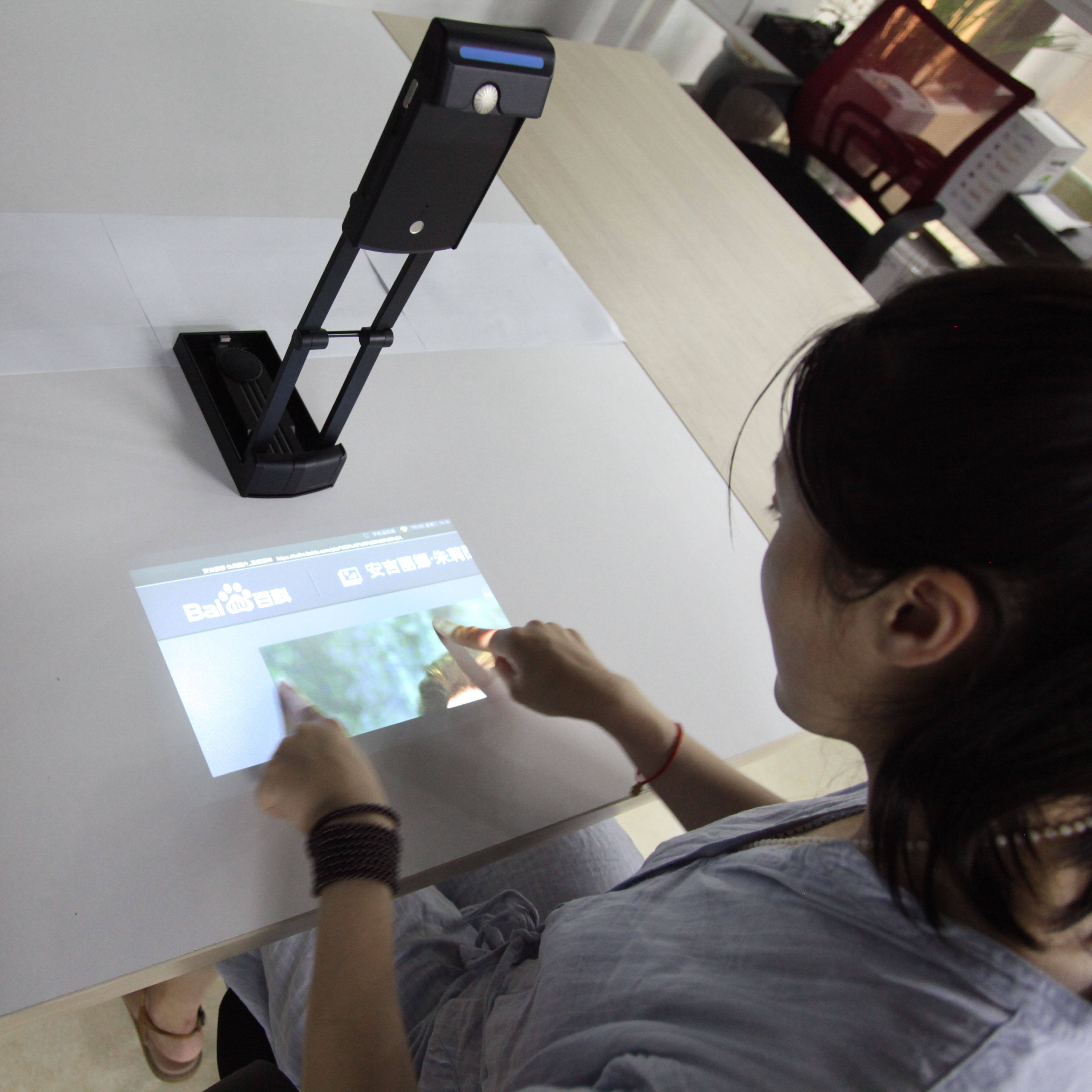 Portable interactive wifi multimedia projector, laser image calibration technology