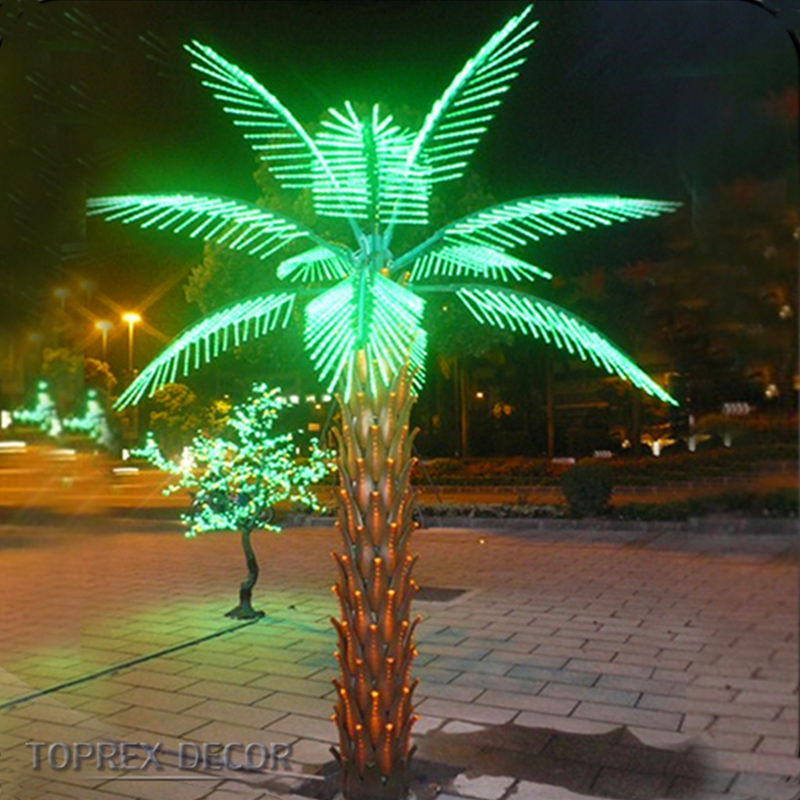 Artificial LED outdoor lighted palm trees illuminate