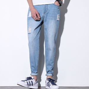Dongguan factory oem custom big hole denim joggers jeans wash blue jean for men