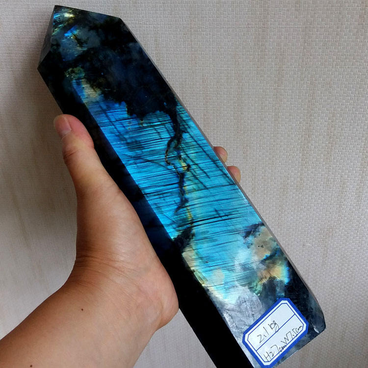 large natural labradorite point with good flash crystal tower