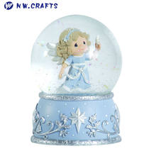lovely little angel holding a star snow globe baptism baby shower souvenirs