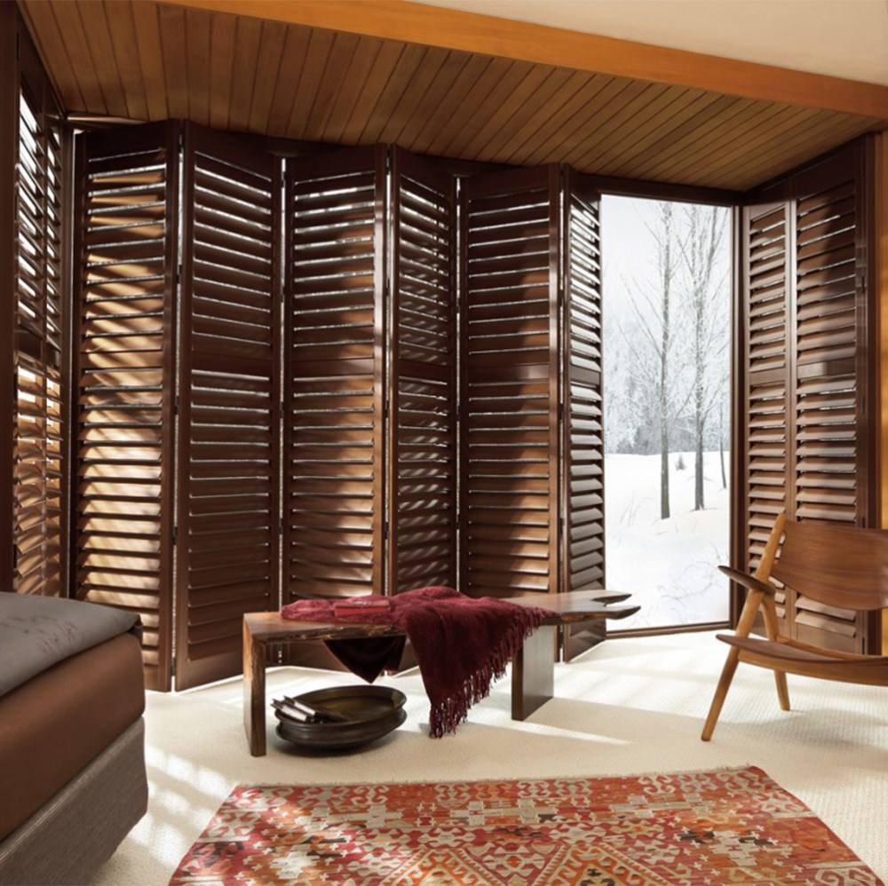 Custom white outdoor wood folding blinds for windows and doors