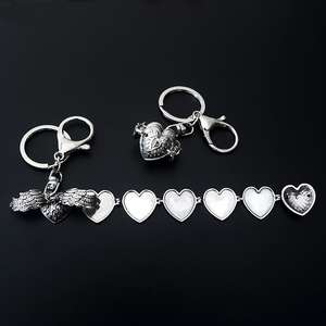 Latest items multilayer foldable heart shape photo frames with wing long pendant key chain love gifts for unisex