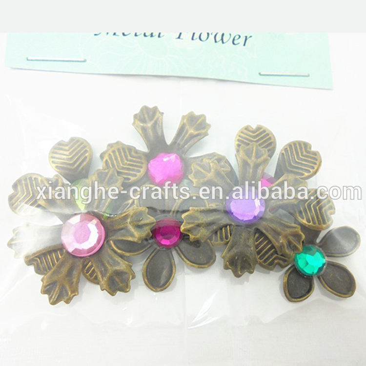 factory direct bulk bronze fashion craft metal flowers with a gem