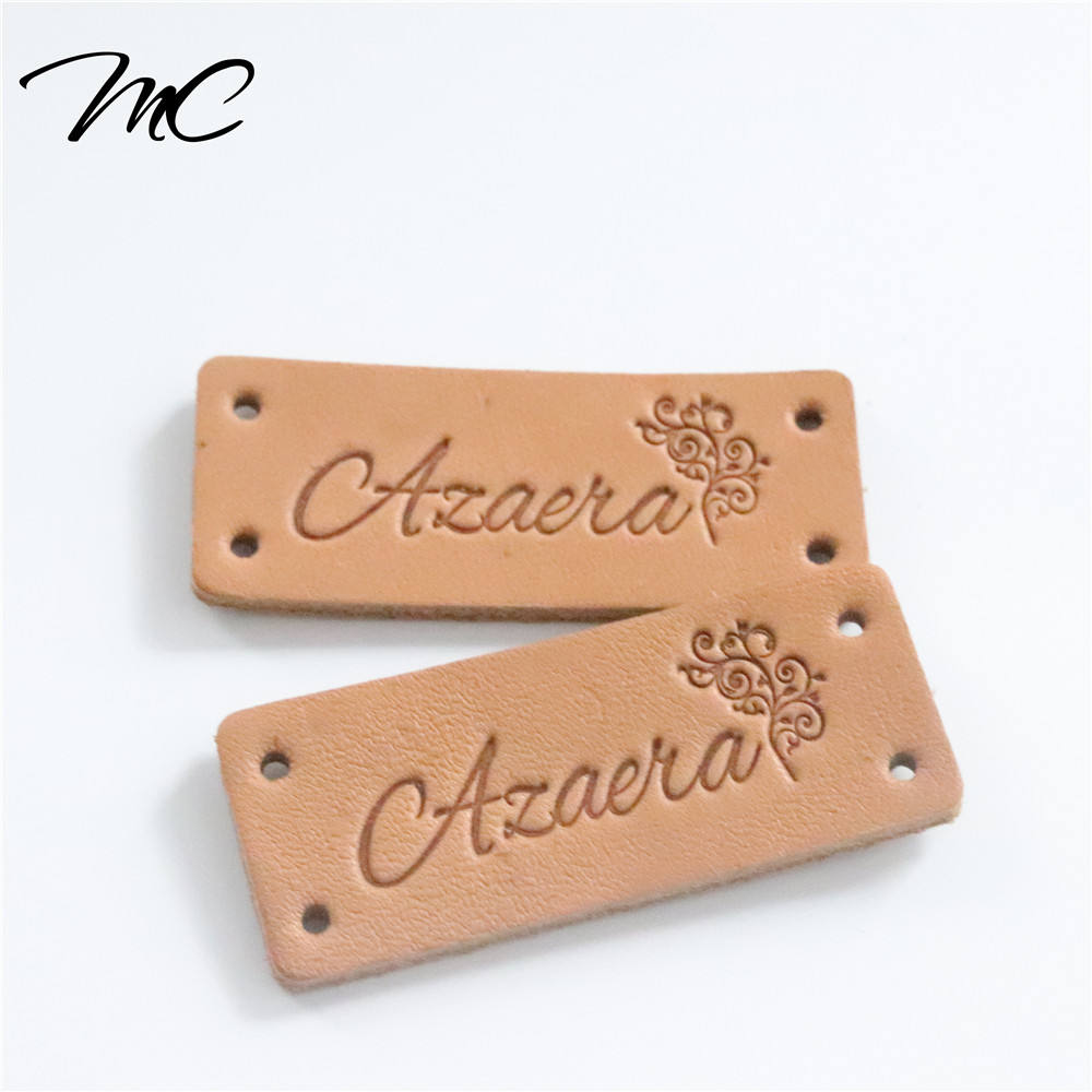 Manufacture brown genuine leather label patch debossed LOGO with holes for clothing/ garment/handbag/ backpack leather tag