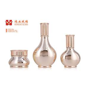 Luxury Packaging champagne gold color empty cosmetic sets spray glass bottle with pump HY2007