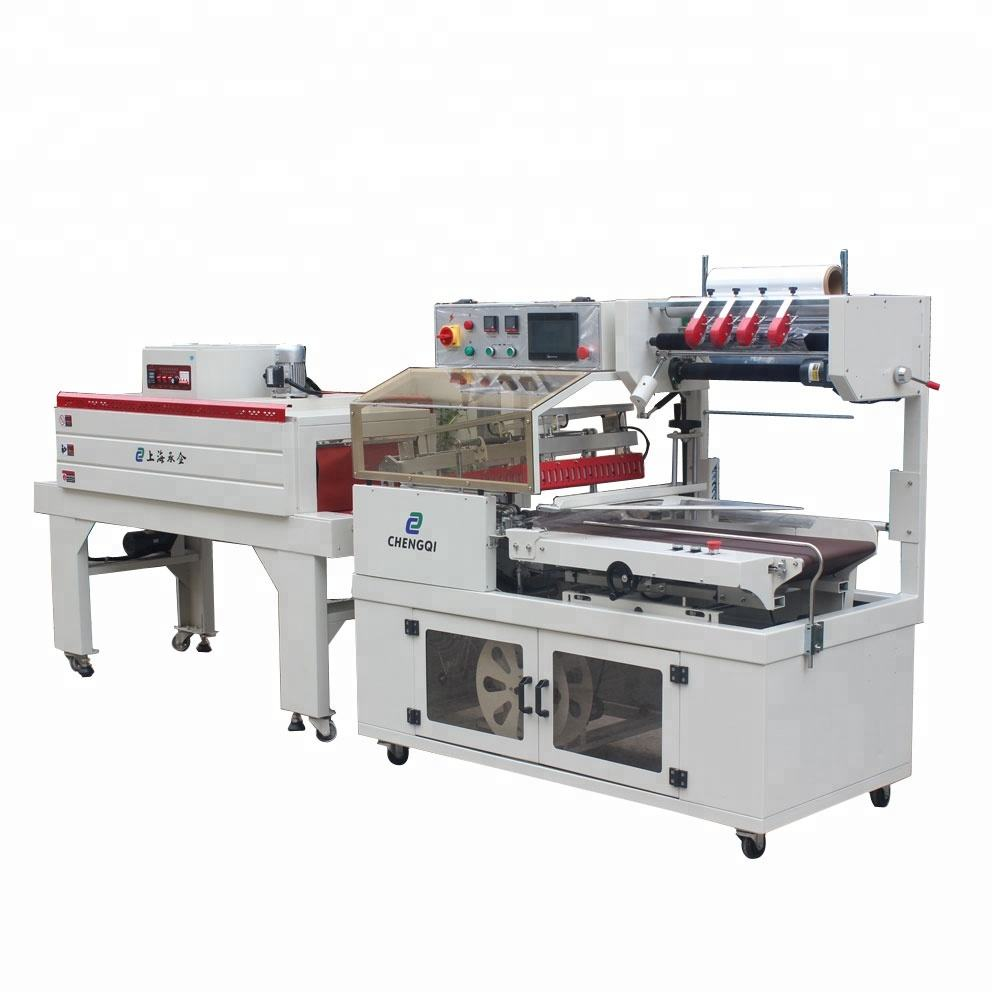 Heat shrink map packaging machine