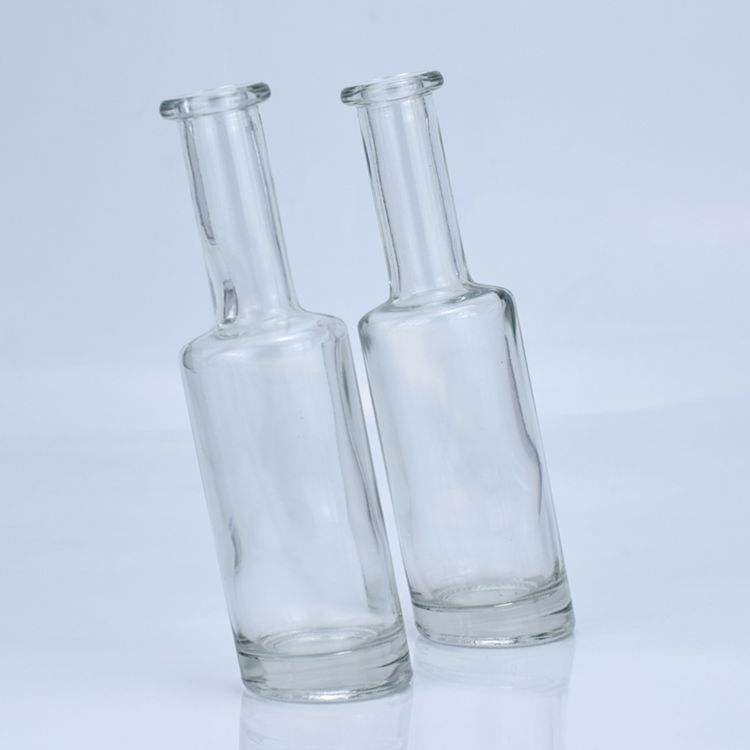 wholesale tilted shape 200ml glass liquor beer bottle with cork