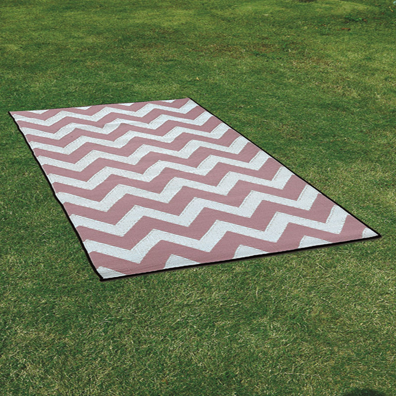 Rolled up plastic play mats / rug with Grass rug