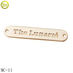 Fashion clothes metal logo design smooth golden metal brand letter label tag for bikini