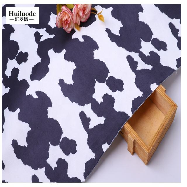 Cheap sales micro warp spandex milk cow printed faux printed suede fabric for coat