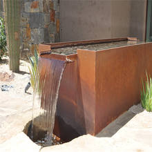 Abstract rusty red metal waterfall sculpture for garden landscape